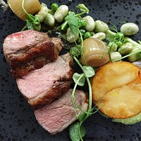 Derbyshire lamb rump, fondant potato, braised shallot, minted pea puree, broad beans, lamb jus.