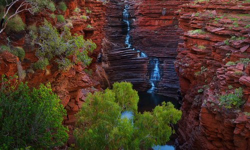 In Karijini NP, Western Australia, you'll find the most amazing gorges and canyons.  This place is suited to older children and teenagers who can swim and withstand the humidity and multitude of insects.  Joffre Falls is only one of the incredible sights you'll find there.