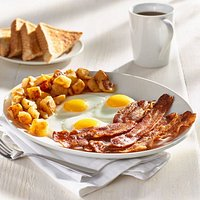 Five strips of premium bacon, three eggs, and home fries served with thick toast.