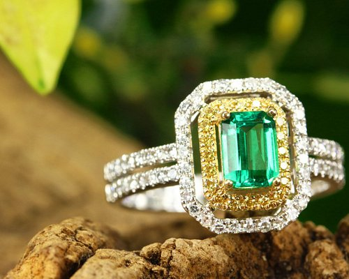 White and yellow diamonds with a center Colombian emerald. All made by yours truly.