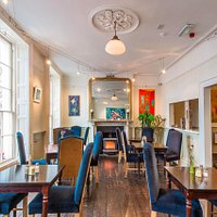 A warm and inviting restaurant, natural wood stove, comfortable seating to relax and enjoy your vegetarian or vegan meal.