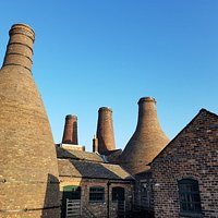 A view of the old bottle kilns at Gladstone Pottery Museum: the iconic shapes of the pot ovens used to be commonplace but now the Victorian site is unique in Stoke-on-Trent. With fantastic activities for families, including throwing a pot and decorating ceramic figures, as well as a toilet-inspired exhibition and chance to see inside a bottle oven, it's a great day out.  [Disclosure: my entry was free for the purposes of review. We spent over three hours exploring and wanted to stay longer!]