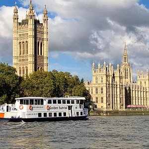 The Golden Sunrise cruising past the Houses of Parliament