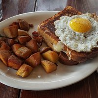Croque Madame - 2 slices of french toast with ham and swiss cheese in between, with a fried egg on top
