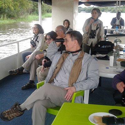 Clients enjoying early morning bird watching cruise along the Mighty Zambezi River