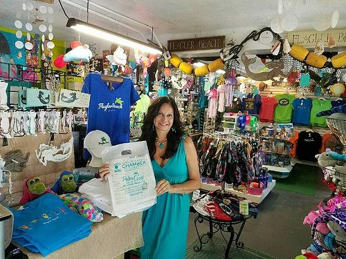 Flagler Beach Gift Shop was voted Best Gift Shop Around 3 years in a row! The store is your one stop souvenir shop with Flagler Beach T-shirts & hats starting at $ 9.99, lots of Locally Made gifts including jewelry & candles. The shop also sells  towels, totes, beach gear, shells, beach decor, sunglasses, toys, sea life plush, boogie boards, Flagler Beach & coastal decals, magnets, coffee mugs, shot glasses, postcards, $ 4.99 Shark Tooth & Shell necklaces, more! Located near Finns at A1a & US100