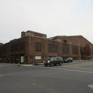 The building is standing mong old warehouses and old buildings on Georgia Avenue