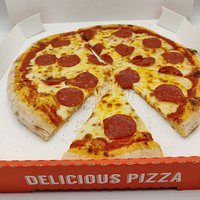 Serving fresh, hand rolled pizza with 100% mozzarella cheese