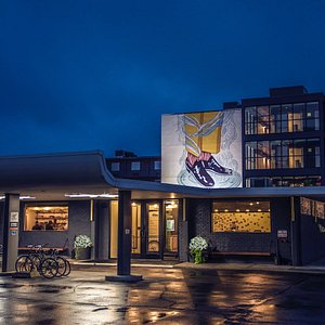 A nighttime exterior photo showcasing one of our artisan murals.