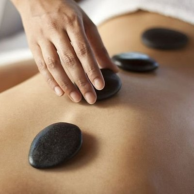 Utilizing smooth, heated stones that are placed on your body, the localized heat warms & relaxes the muscles, allowing the massage therapist to apply deeper pressure.  Increases circulation and promotes relaxation.