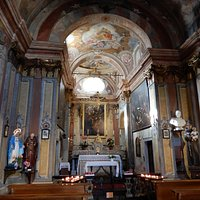 Another view of the interior of San Rocco showing paintings to the side of the altar