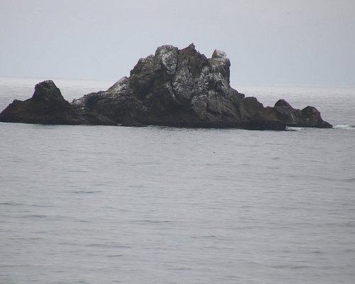 A huge boulder in the ocean