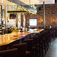 The bar at Lonesome Dove Austin, feat. happy hour food & drink specials Mon-Sat, 4-6:30PM!