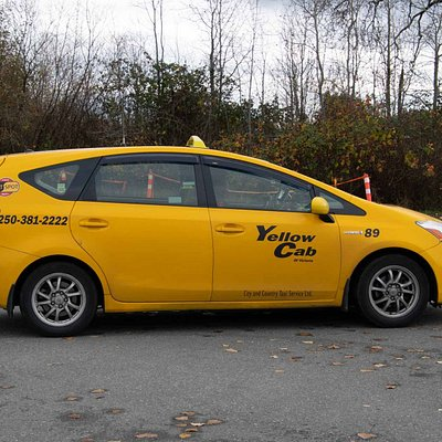 Side View of Prius V of Yellow Cab of Victoria