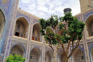 """The Registan was the heart of the ancient city of Samarkand of the Timurid dynasty, now in Uzbekistan. The name Rēgistan (ریگستان) means """"Sandy place"""" or """"desert"""" in Persian. The Ulugh Beg Madrasah, built by Ulugh Beg during the Timurid Empire era of Timur—Tamerlane, has an imposing iwan with a lancet-arch pishtaq or portal facing the square."""