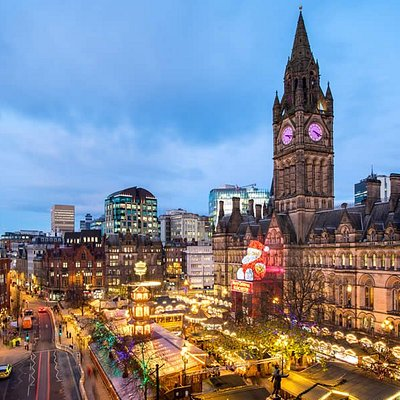 The famous Manchester Christmas Markets in Albert Square with 'Zippy' overlooking the festivities from the Town Hall.
