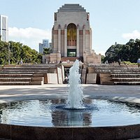 View of the Anzac Memorial and the new Centenary Extension Cascade from Liverpool Street.   The Cascade and the Centenary Exnteion was built to mark the 100th anniversary of the First World War and finally realise Bruce Dellit's original vision