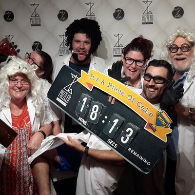a group of 6 enjoying the success of beating the Dr. Irov's Laboratory