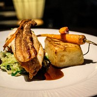 Pan Seared Chicken Supreme, buttered savoy cabbage, smoked bacon crisp, maple glazed carrot, pomme fondant, chicken jus