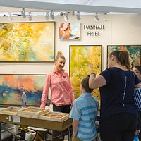 Visitors enjoying the work of Hannah Friehl at Celebration of Fine Art in Scottsdale, AZ