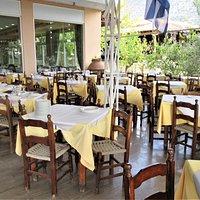 Covered outdoor patio of King Menelaos Restaurant.