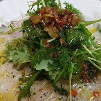 Fish carpaccio with micro greens and Tuscan sauce