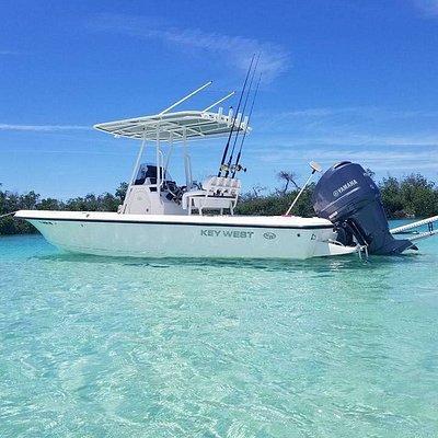 25 ft Key West Bay / Reef powered by Yamaha 200 four stroke, 6 speaker rockford fosgate audio system, power pole, Garmin fish finder with plotter. 2 live bait wells.