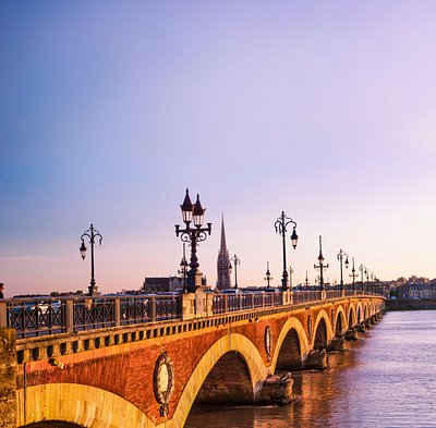 "The Pont de pierre, or ""Stone Bridge"" in English, is a bridge in Bordeaux, which connects the left bank of the Garonne River to the right bank quartier de la Bastide."
