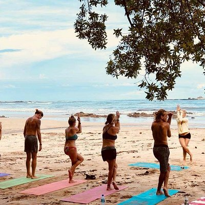 Beach yoga is beautiful and sandy and breezy and uneven and has the best view