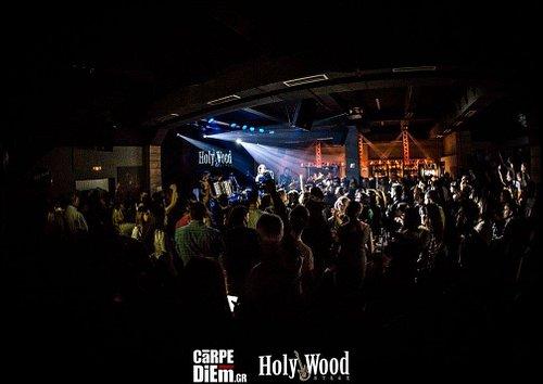 HolyWood:Ευλογήμενο Ξύλο Στον πολύ ιδιαίτερο χώρο του HolyWood Stage σε ένα από τα παλαιότερα εργοστάσια επεξεργασίας ξύλου και παραγωγής επίπλων στην Ελλάδα κατασκευάστηκε ένα live stage εξαιρετικής ακουστικής που δημιουργεί μια μοναδική επαφή μεταξύ ερμηνευτών και κοινού όπου οι καλλιτέχνες έρχονται να συναντήσουν το Αθηναϊκό κοινό σε μια σπάνια μουσική εμπειρία!  Το HolyWood Stage ήρθε για να δώσει στα βράδια σας μια διαφορετική χροιά…!