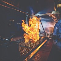 Chef/Owner Frank Ostini at the famous Hitching Post 2 grill