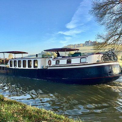 One of the hotel barges cruising along the canal  between locks 10 & 11 near Chateauneuf-en-Auxois