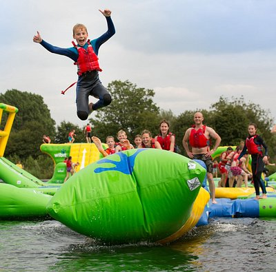 Leap from the awesome Wibit AquaVenture at the Cotswold Country Park & Beach! After an action packed hour on the inflatable waterpark, relax on the soft sandy beach & take a dip in the lagoon. Fill hungry tummies at the Pizzeria or Beach Shack, glide out onto the lake in your swan pedalo, zoom through the start gate in an electric miniport boat & race to the lighthouse. Head to the waterports lake for Kayaks, SUPs, Canadian Canoes or stay on dry land with activities for all! Book online today!