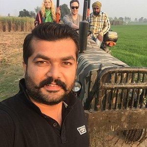 Me organising village tour