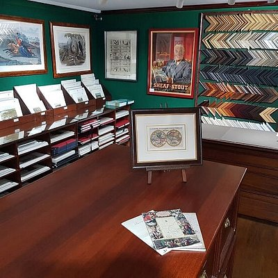 A shot of inside our gallery. In view is a small framed world map from the 18th century, a beautiful aquatint titled Belle of the Hunt, John Gould's double page Bower Bird and a vintage poster of Sheaf Stout. We also do in-house framing.
