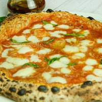 Margherita con bufala!  San Marzano tomatoes, fresh buffalo mozzarella, basil and Extra virgin olive oil.