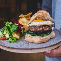 Burger with Portobello mashroom, goat cheese, spinach, fried egg. Served with sweet potato chips and green fresh salad.