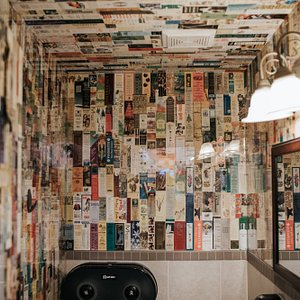 Our iconic Bookmark Bathroom is the ultimate selfie background.  It is one of our trademarks to wallpaper our branch's bathrooms with bookmarks that we find inside of the hundreds of thousands of books that pass through our stores each year.  (Photo credit Julie Christine Photography