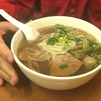 TAI NAM - Beef noodle soup with rare sliced steak, flank, and meatballs.