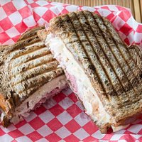Our famous reuben sandwich. Made with homemade russian dressing, swiss cheese, sauerkraut, and corned beef. It is served hot off the panini press on our marbled rye bread.