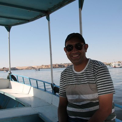 Our awesome Tour Guide Daniel taking a ride on the Nile by motorboat