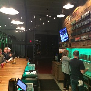 Don't let the empty space behind the bar fool you! To the left, you'll see a packed bar on a Friday night.