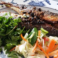 Crispy fried sea Brass with garlic and black bean sauce with salad