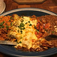 Bandera- three enchiladas, chicken, pork and cheese with three different sauces, red, green and white
