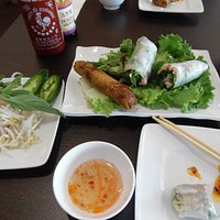Chargrilled Chicken Spring Rolls and the Vetinamese Deep Fried Egg roll . The condiments for the pho noodle bowl is with fresh bean sprouts, basil leaves, hot jalapeno peppers and wedges of lime and a light dipping sauce. Yummy !