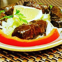 "Homade vine leaves wrapped with tasteful ingredients  ""Dolma"""
