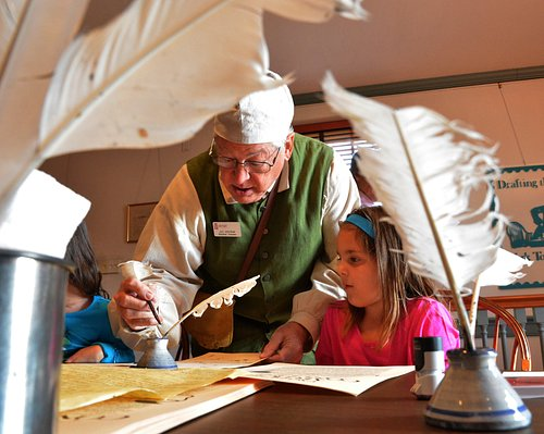 A volunteer staff member at the Colonial Courthouse during Articles of Confederation Day.