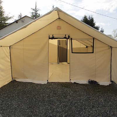 14'x16' Deluxe Wall Tent with 3 windows, 2 doors with mosquito nets, internal frame, porch, floor, tarp, and stove/warming tray/water heater.