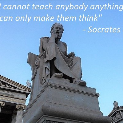 Seated marble figure of Socrates in front of the entrance of the main building of the Academy of Athens.