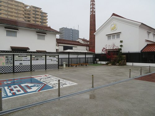 The sake brewery in the back is Hakubotan, the oldest brewery in the area established in the 17th century. Notice the sharp contrast of the modern high rise buildings in the far back and the old sake brewing area.